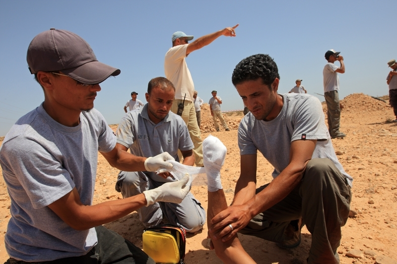 Emergency treatment being provided in the field. Photograph provided by UNMAS.