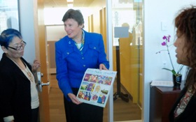 Ms. Kane showing the Gensuikyo delegation a 2013 calendar comprised  of UN Art for Peace contest winners art works